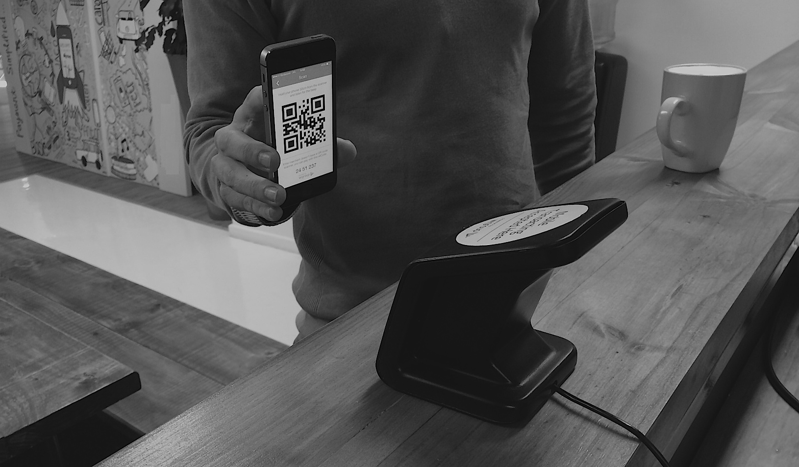 Above: TuYu mobile wallet user pays for a coffee using a unique QR code.